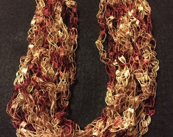 11 strand crochet ladder yarn necklace in maroon and beige.