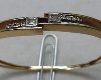 14 karat yellow gold hinged bracelet with diamonds