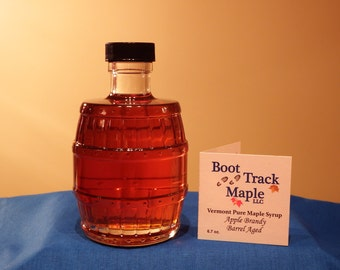Apple Brandy Barrel Aged Vermont Pure Maple Syrup in a glass barrel bottle