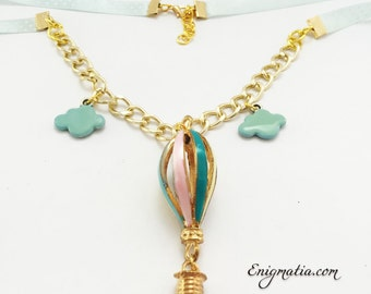 Wonderful necklace with globe and clouds