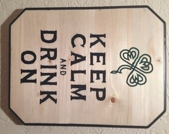 "Hand carved wooden sign ""keep calm and drink on"""