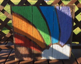 Hand painted rainbow and cloud on barn boards