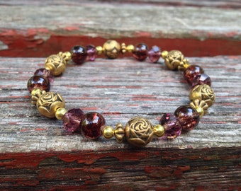 CLEARANCE***Elegant gold and garnet beaded bracelet