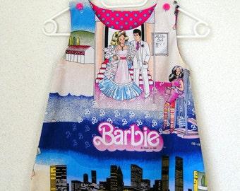 A lijn jurkje pinafore Barbie (size 5-6)