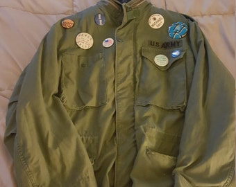 Vintage  US army  field jacket with 1960s anti war buttons