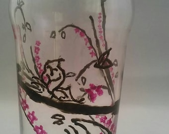 Hand painted pint glass, pink and black tattoo style butterflies and flowers.