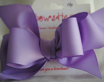 Grosgrain ribbon bow on hair clip.  Many colors available.