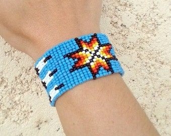 Beads Bracelet hand sioux Indian pattern-woven Blue Star background and feathers made in France