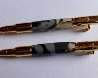 Bolt-action bullet ballpoint pens.
