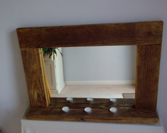 Mirror with shelf built from reclaimed scaffold board. Rustic handmade