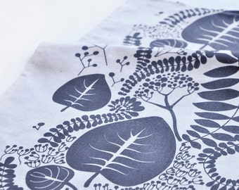Linen tea towel hand printed with floral ornament