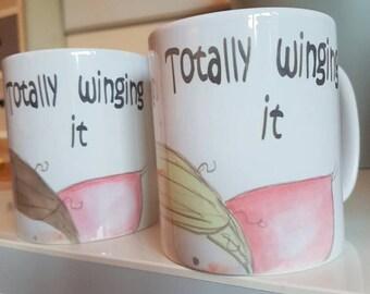 Totally winging it fairy print mug