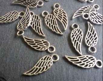 16 Lovely Little Hollow Bird or Angel Wing Charms Silver Tone 18x7mm