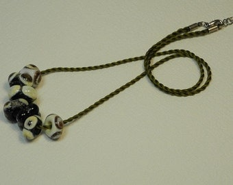 Necklace, ras Mokuba silk cord, Khaki, with 7 neck beads glass square, decorated with points, white, black, ivory, Brown