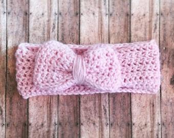 Crochet pink bow headband.