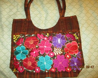 Beautiful yucatecan brown purse with bright flowers