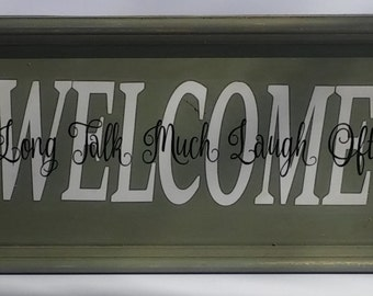 """Wood sign """"Welcome Sit Long Talk Much Laugh Often"""""""