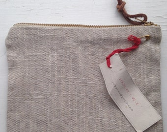 Raw linen zip purse with organic cotton gingham lining.