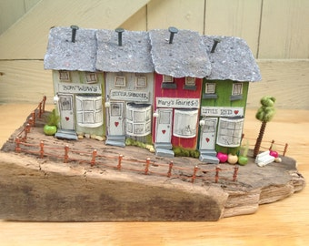 Quality Street...row of driftwood shops/cottages