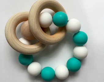 Teething Rattle in Turquoise and White with free trade North American Hardwood rings