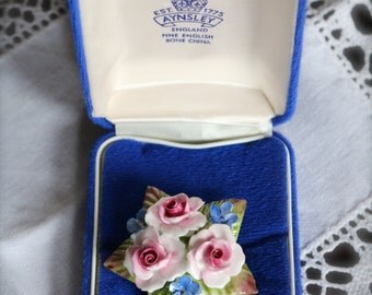 Beautiful Aynsley Brooch in original box.  Excellent condition