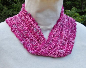 handknit sparkly mobius scarf or cowl of handpainted pinks cotton yarn