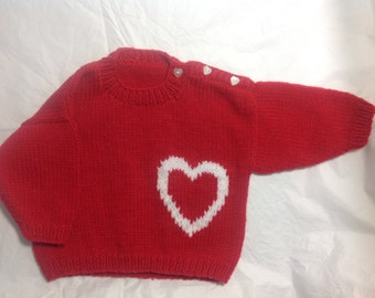 Red hand knit baby sweater