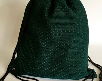 Backpack from green cotton with dots pattern