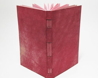 Pink leather notebook with padded for taking notes or sketches