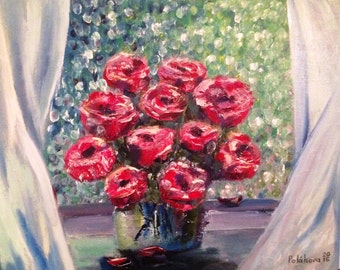 Garden roses on the windowsill