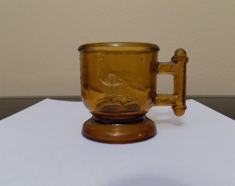 Vintage Amber Cup with bird and grass