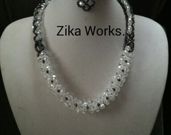 crystal white and purple necklace and earrings.