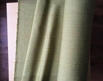 Fabric. Hand woven. 100% wool.