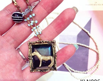 Black and gold Zebra pendant necklace