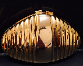 Golden clutch with long gold chain. Purse, bag