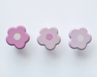 Cute Flower Drawer Knobs. A beautiful addition to any little girls room, playroom or nursery. In shades of pink.