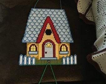 Four seasons little cottage plastic canvas wall hanging
