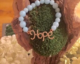 Hope charm beaded bracelet