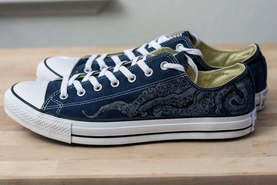 7661b0e7ca5475 A nautical-themed hand-painted design on authentic navy blue Converse  All-star low top shoes made using permanent acrylic paints and artist pens.