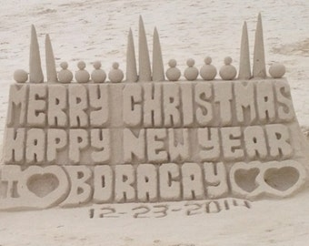Place your greetings in a sand castle
