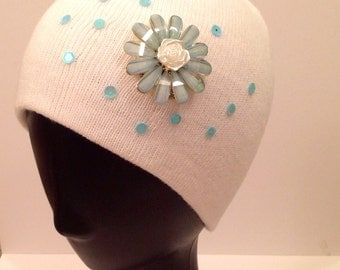 White beanie bedazzled with aqua flower & sequins