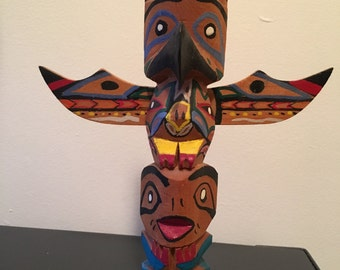 1968  totem hand carved by Chief White Eagle