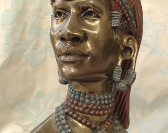 Bronze Head of a Maasai Warrior by James Tandi.