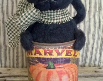 Primitive Black Kitty in a Rusty Pumpkin Can