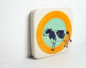 tile with a holstein cow on a colour block of orange and blue green, Ready to ship.