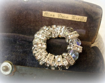 rhinestone rondelle supply 19 pieces total 8mm square and 7mm rounds bright silver setting