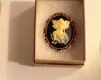 SEATED Ivory colored Flower FAIRY CAMEO set in Goldtone black colored background