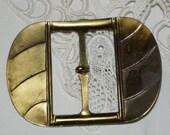 Antique brass buckle