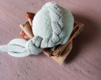 Textile brooch pale blue with braid and pleated cotton