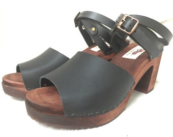 Open toe Black oiled Mary Jane on a brown Super High Heel with wrap around ankle strap